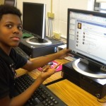 Marqis Turner shows off the Facebook page he built for Patrick Henry.