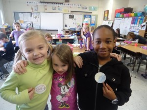 Students from Mrs. Thomson's first grade class at John B Dey Elementary made a pledge not to bully and made buttons to wear too. Pictured from left to right are Karsyn Hester, Madison Jeffreys and Trevin Griffith.