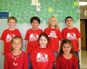 From left to right, in the front row, Olivia Evener, Elena Caputi, Jeannette Ngugi , and from left to right, in the back row, Mason Wadleigh, Jesse Gutierrez, Bryan Turnage, Ryan Studley all proudly wear their red.