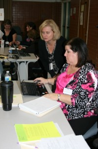 Tammy Spears, department chairperson for the Preschool Assessment Center, collaborates with special education coordinator Chris Cohoon during a recent training session for preschool teachers.