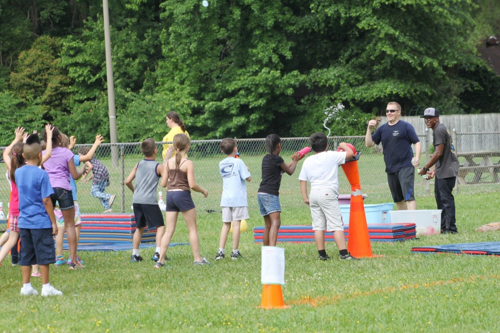 Volunteers from the squadron lead students in Field Day activities.