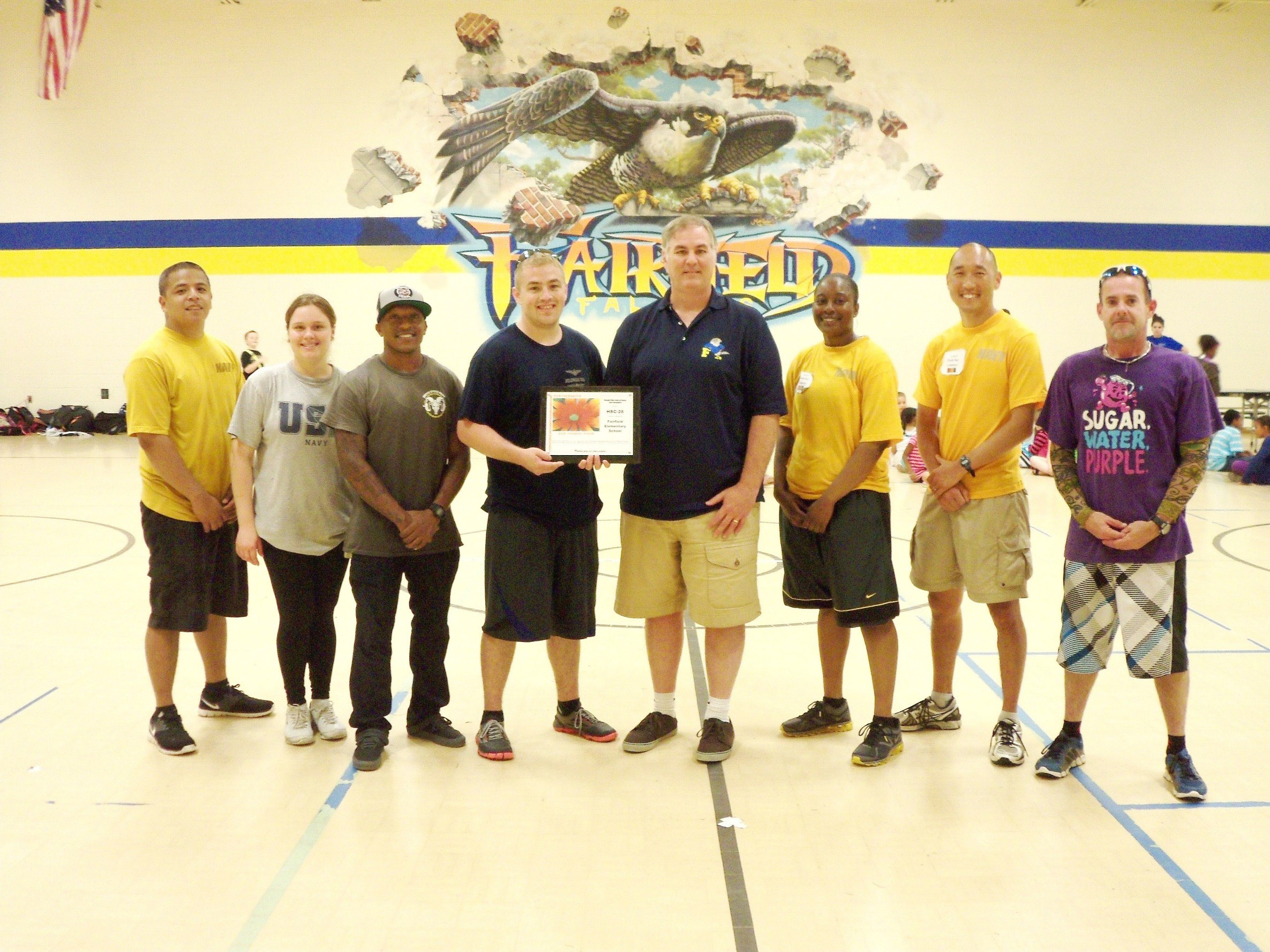 Members of the Navy team with principal Mr. Knapp (center), and PE teacher, Dave Matney (far right).