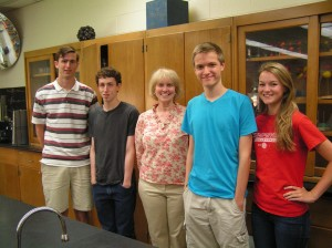 Ben Clarke, Nate Shue, Matt Wrocklage and Kelli Green stand with teacher Maureen Morse (center). The students competed in the 2013 Chemistry Olympiad.