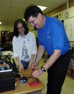 Dr. Suely Black, from Norfolk State, and Princess Anne teacher Roger Crider check an activity.