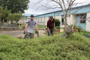 PO1 Justin Sanders PO1 Casey Collins help the landscaping around Plaza Middle School.