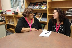 ShineGIRL team leader Cheryl Lawrence and LKMS student Marianna Harris take a few moments to share a laugh.