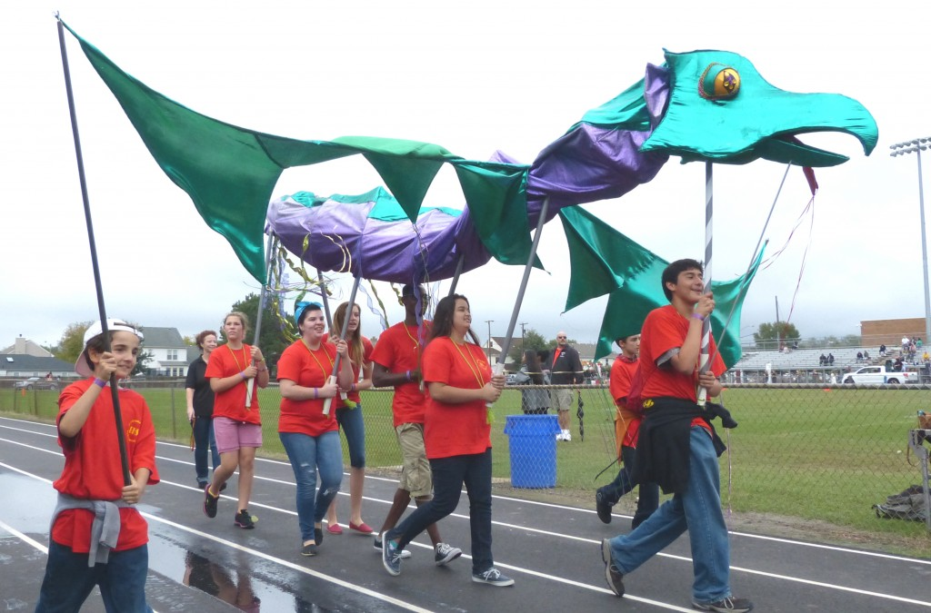 Shadrach briefly left the classroom to march in the Bayside Homecoming Parade.  Pictured carrying Shadrach from left to right are Angelo Perez-Sanders, Charity Mansell, Cassie Schule, Joselyn Harris, Wayne Sparks, Justice Smith, Orion Perez-Sanders and Mario Perez-Galvez.  Bringing up the year is teacher Rachel Gardner.