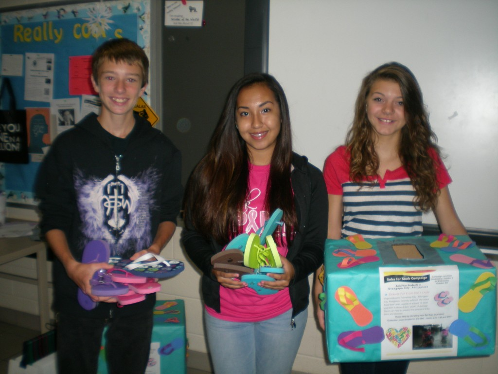 Austin Beavers, Carresa Talens Pagan and Rachel Kidd collected flip flops for their sister city.