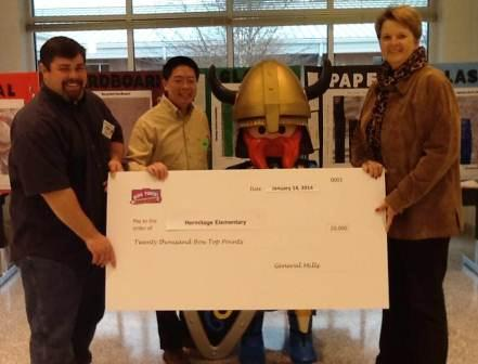 Simon Eng, a representative for General Mills, presented the award check to the Hermitage PTA Box Tops for Education coordinator Dave Risden and Hermitage principal Holly Coggin.
