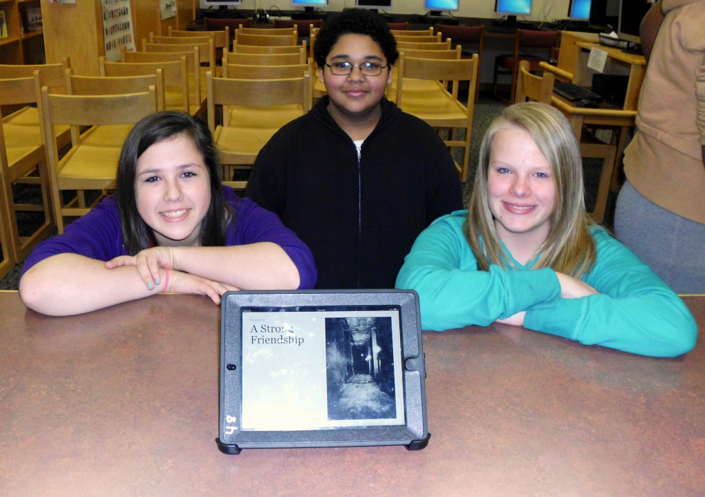 Skyla Durant, Xavier McNeill and Alayah Hughes showcase their iBook.