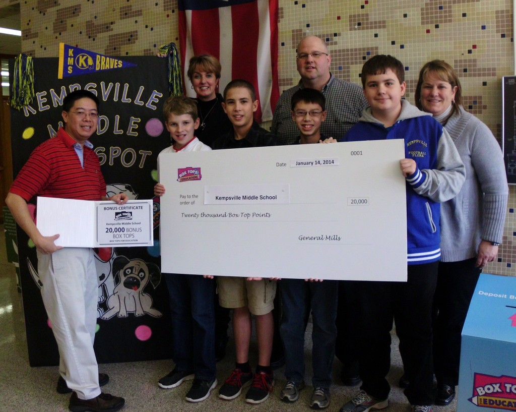 Receiving the award from Simon Eng (left) are students (l to r) Kodi Masisak, Andrew Duplain, Brandon Eng and Doug Flora. In the back row are Dr. Patti Jenkins, principal, Rod Hesson, and Lisa Masisak, student activities director.