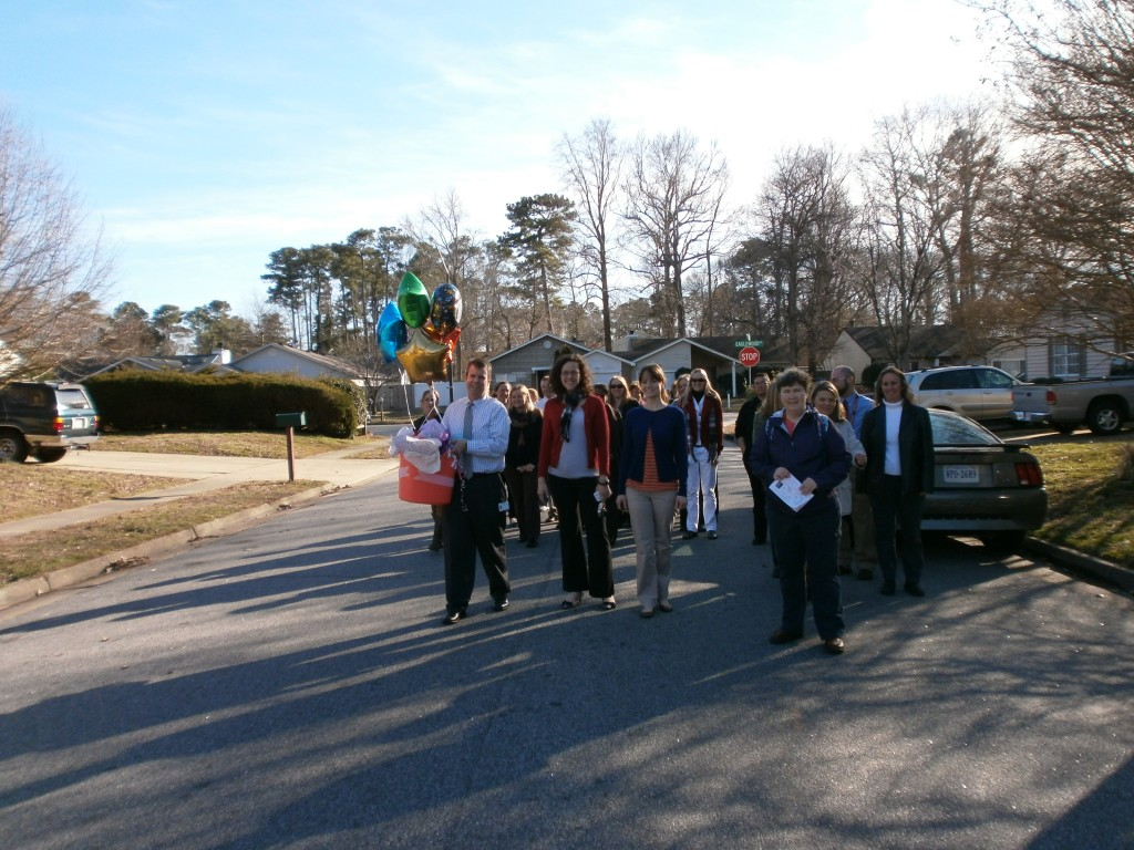 Most of the Corporate Landing staff walked to Grace Mozingo's house to present her with the Dynamic Dolphin award.