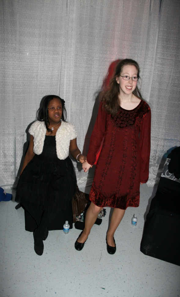 Caroline Williamson helps Zaria Wilson to the dance floor.