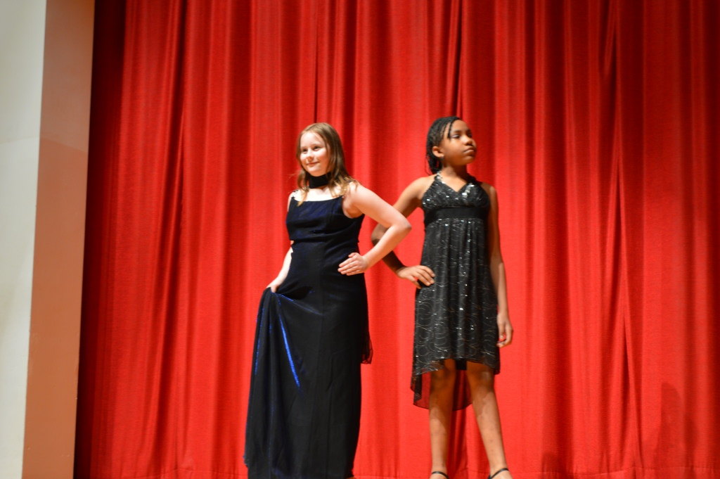 Alyssah Hannahs and Tammy Cooper model their formal dresses at Bayside Middle School's Talent Show.  The girls are members of the Lady'z Club.
