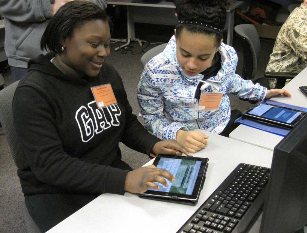 Danielle Davis, and Teagan Flowers from Plaza Middle School test the security of their passwords on the Web in the Computer Avengers Group.