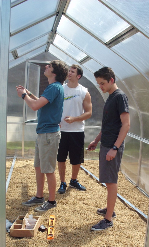 Jack Weers, Zach Smith  and Colin Stolle work on the new greenhouse at  Cox High School.
