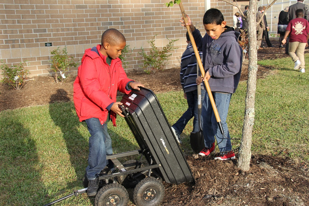 "Seatack Elementary's ""Breakfast Club"" members work in their school garden."