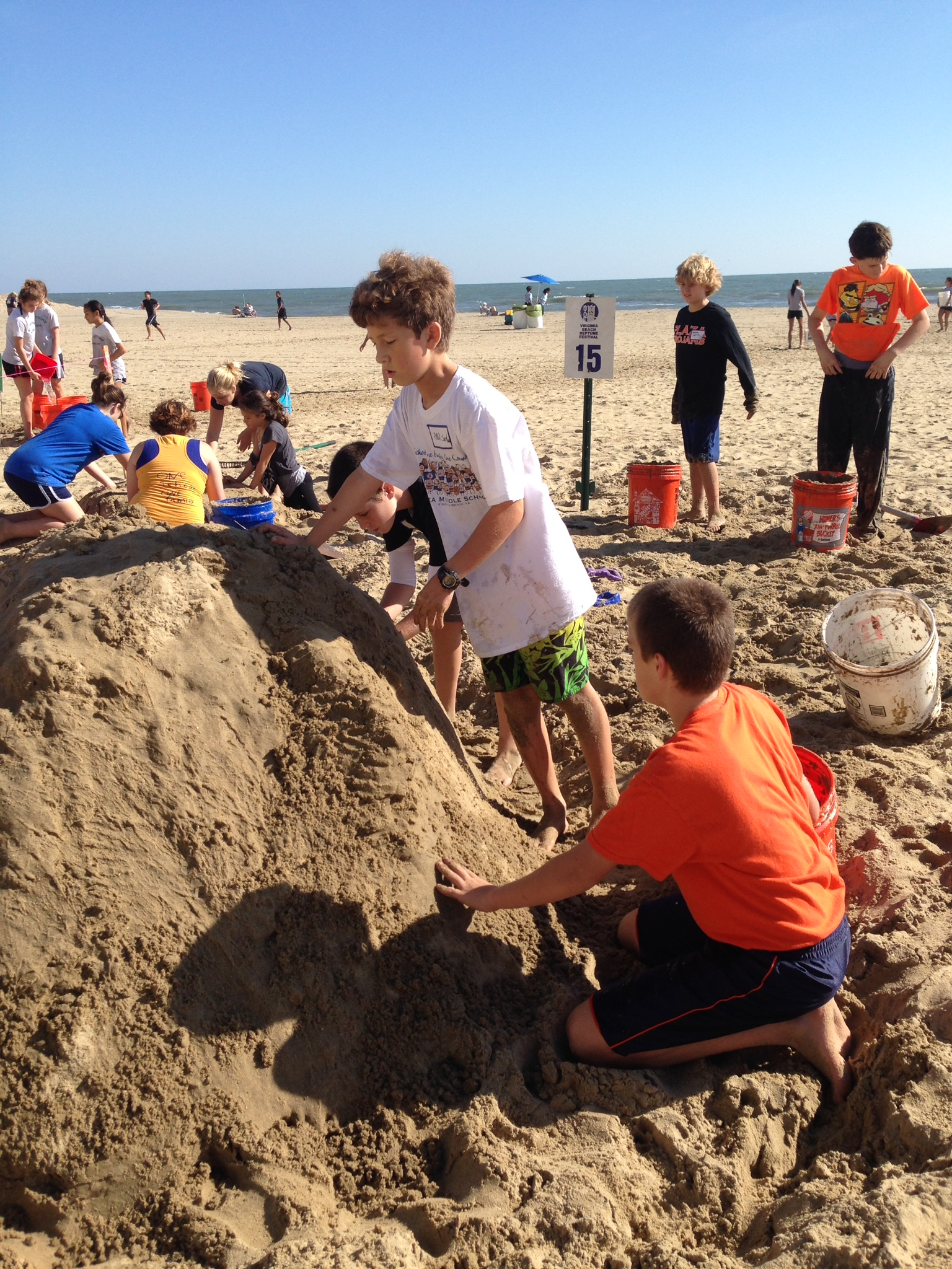 "Plaza Middle School students competed in the sand sculpting competition at the Neptune Festival. This year's theme was ""The Works of Dr. Seuss."" Here, Plaza students Paul Sartwell, Mason Zahn, and Mason Spruill are creating ""Grinch Mountain."" Plaza had more than 20 students plan and organize this year's sculpture."