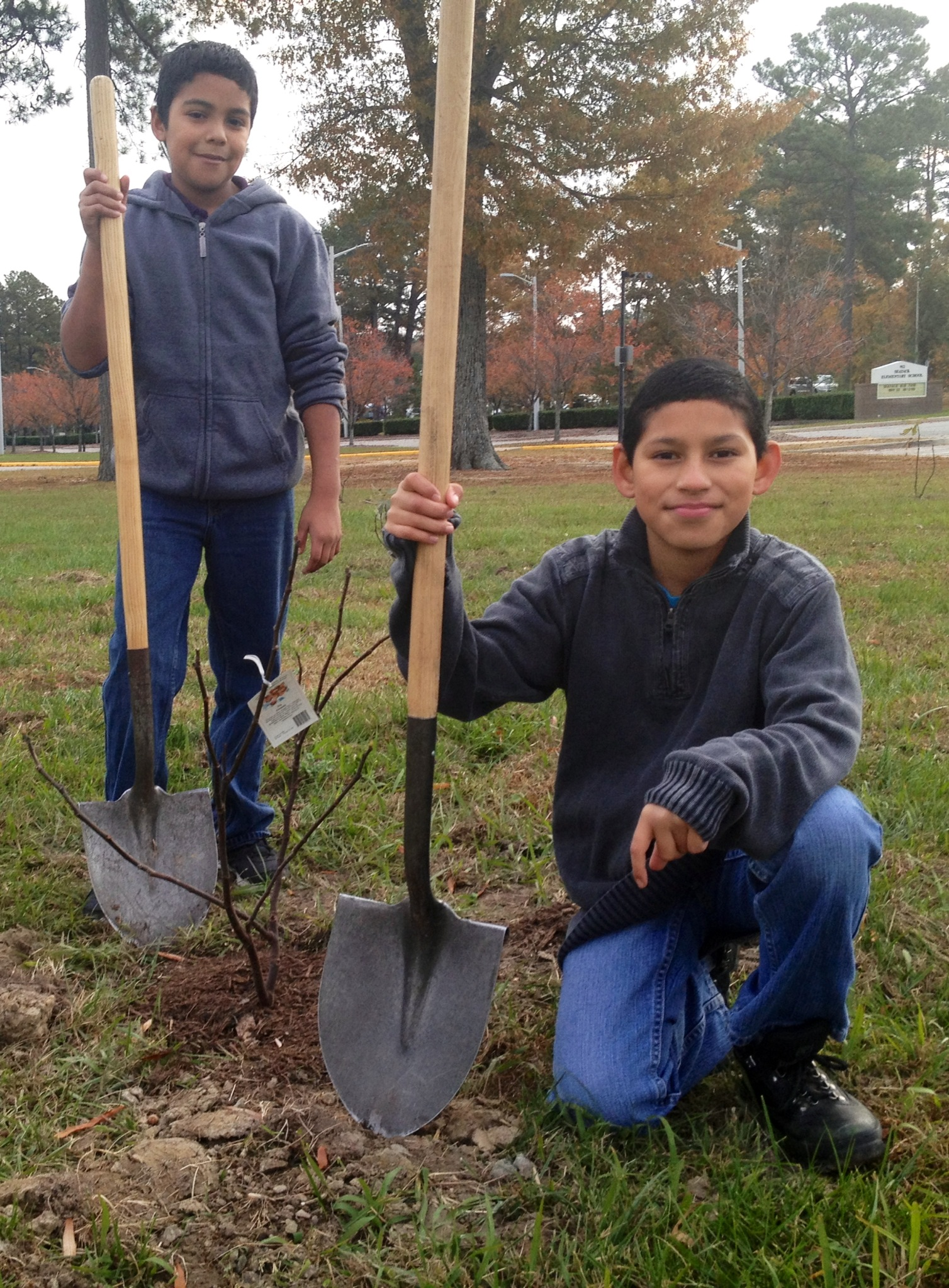 Garden Breakfast Club members, Kevin Perez and Gerardo Ramirez- Quinoes, planted six fig trees for each grade level K-5 with the help of Seatack Elementary's new Partner in Education (PIE) HOPPER Information Service Center, USN.