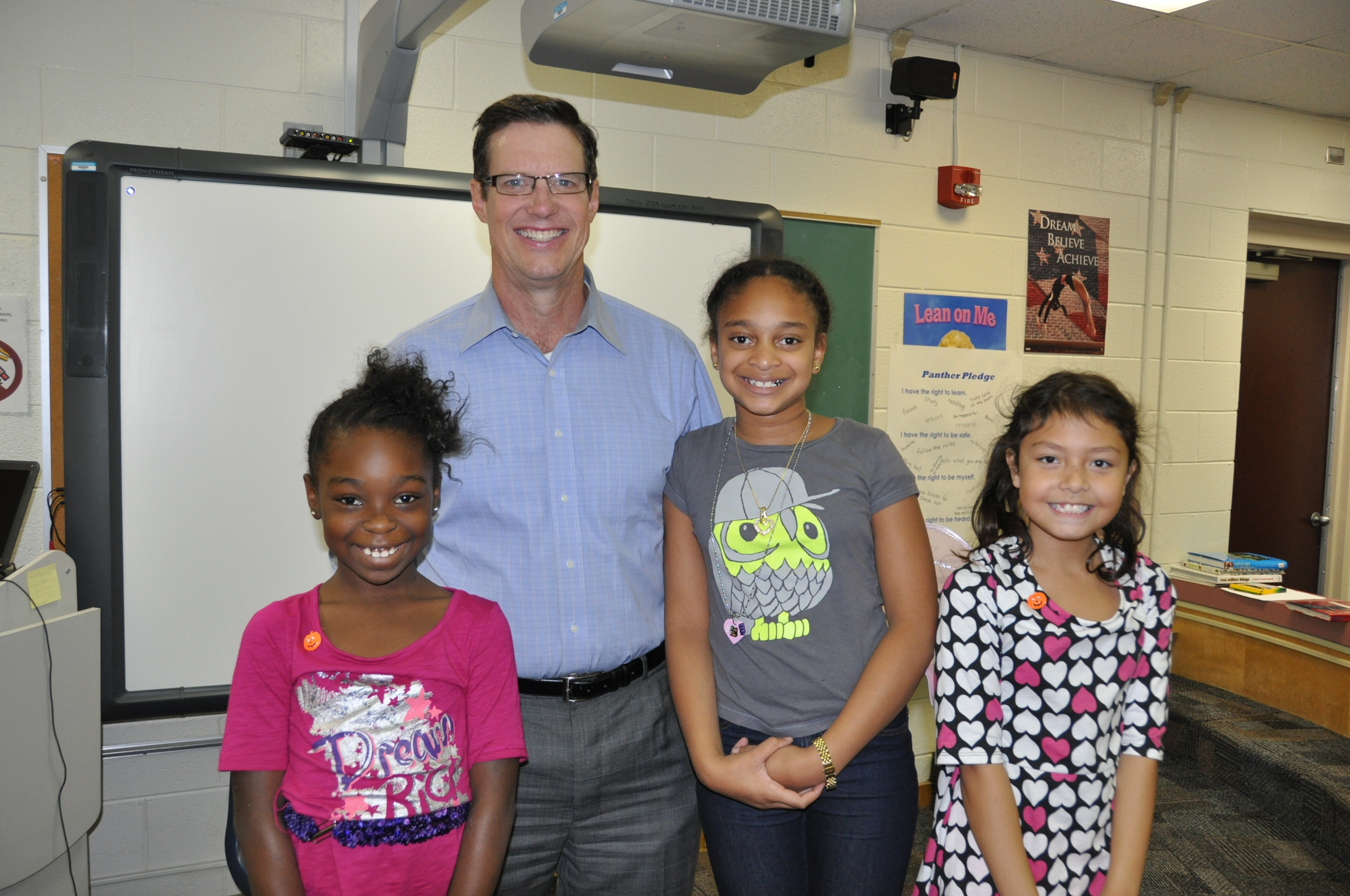 Jeff Lawson, meteorologist from WVEC News Channel 13, talked to Parkway Elementary School's fourth-grade students about the SOLs related to the weather. Shown here from left to right are Nakiyia Cason, Jeff Lawson, Tayla Benson and Alyssa Stevens.