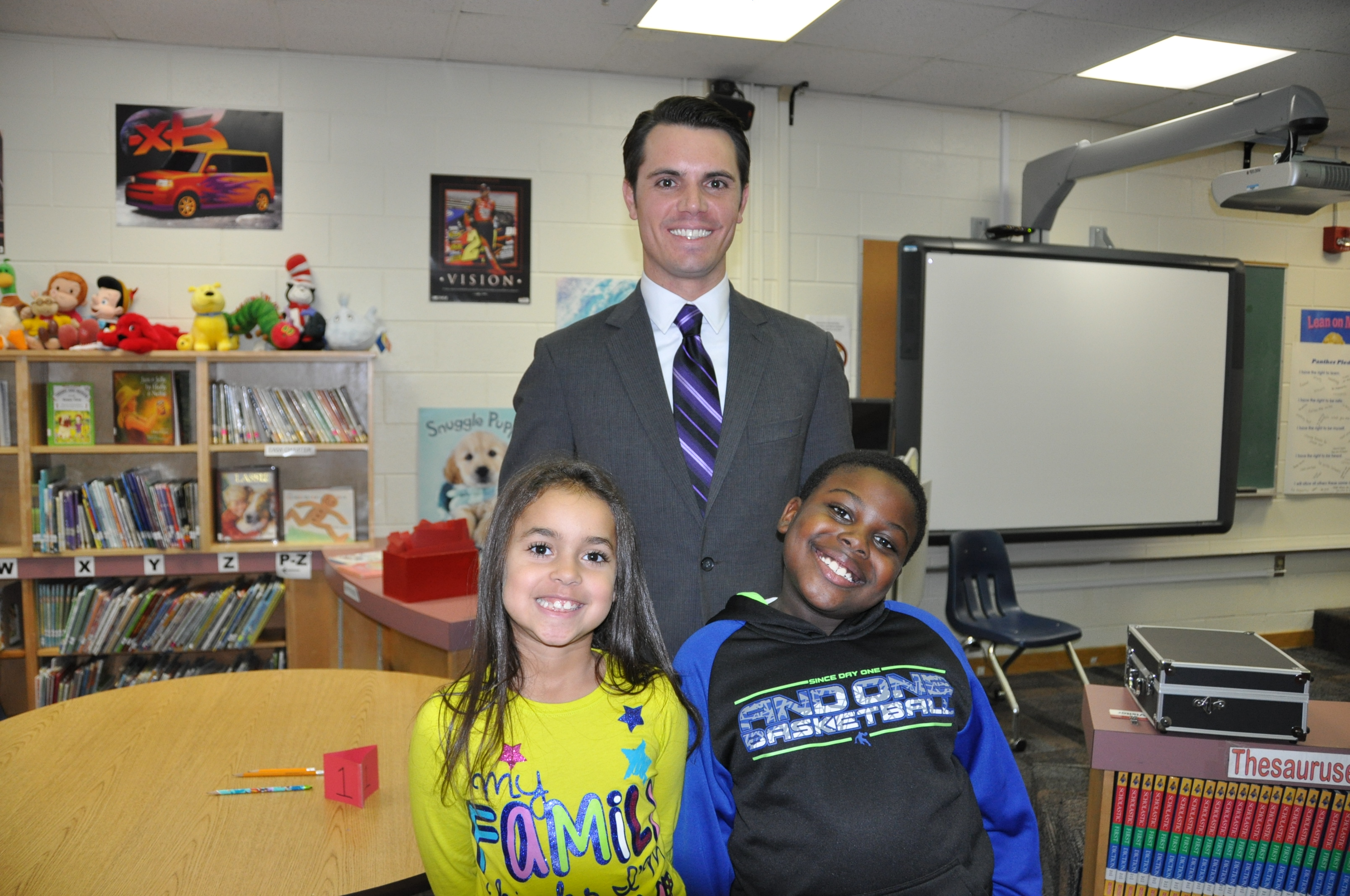 Myles Henderson, meteorologist from WTKR News channel 3, Liver VPIR Forecast Team talks to second-grade students at Parkway Elementary School about the SOLs that relate to the weather.  Shown here from left to right are  Alisha Possien, Troy Lawrence and Myles Henderson.