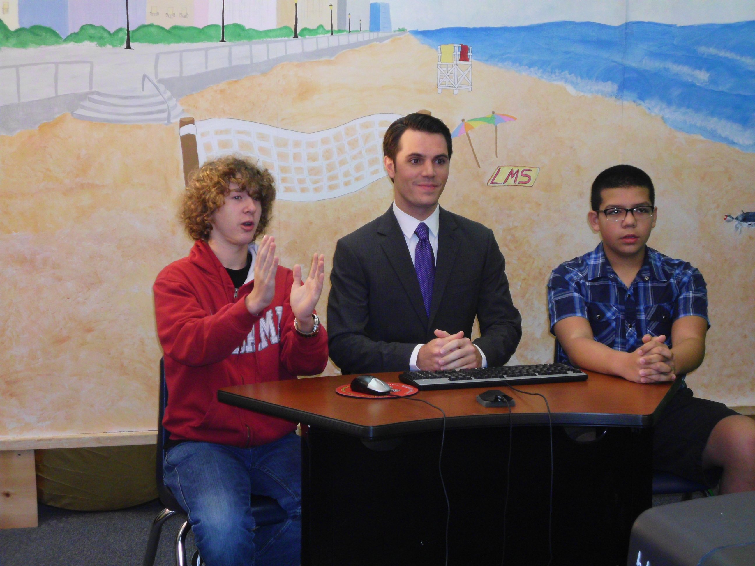 WTKR Meteorologist Myles Henderson joined Landstown Middle School's Channel 21 Crew for the morning announcements and then spoke to all Earth Science students about a career in Meteorology, the Jet Stream, the Polar Vortex and Lake-Effect Snow.  Here, from left to right, are eighth-grader Ethan Snyder, Meteorologist Myles Henderson and eighth-grader Jacob Sekerak.