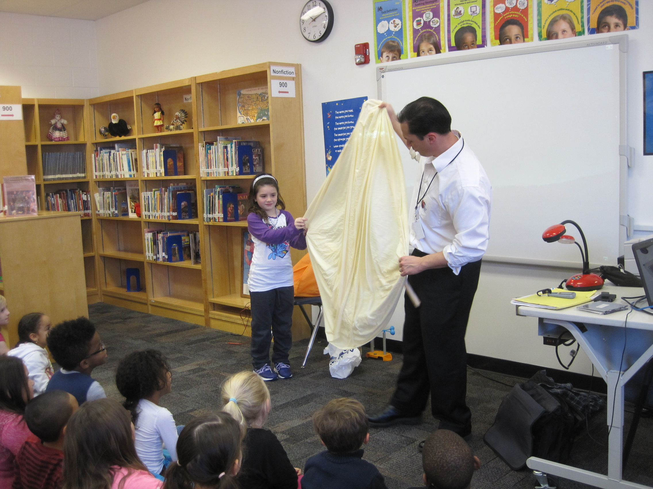 WAVY TV 10 meteorologist Jeremy Wheeler recently visited second grade classes at Bayside Elementary. He talked about weather forecasting, explained the use of weather instruments, and showed exciting video excerpts from storm chasing. In the picture, second-grader Jeslyn Colon helps him hold up a weather balloon.