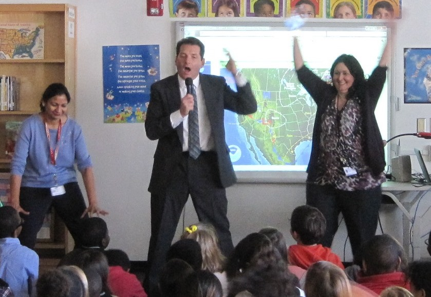 When WVEC TV-13 Weatherman Craig Mueller recently visited fourth-grade classes at Bayside Elementary, he invited two teachers to assist him.  In the picture, fourth- grade teacher Nisha Jain, Craig Mueller, and fourth- grade teacher Tania Vadala demonstrate the movements of hot and cold air masses.