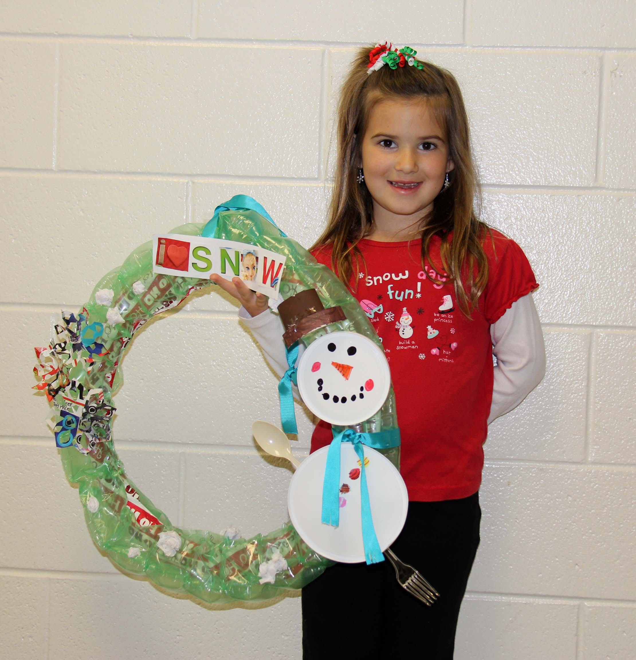 "First-grader Aubrey Leggiardro's wreath, ""I Love Snow,"" won a second place award for creativity. Her project was made of bubble wrap, wrapping paper, paper towel rolls, plastic utensils and lids."