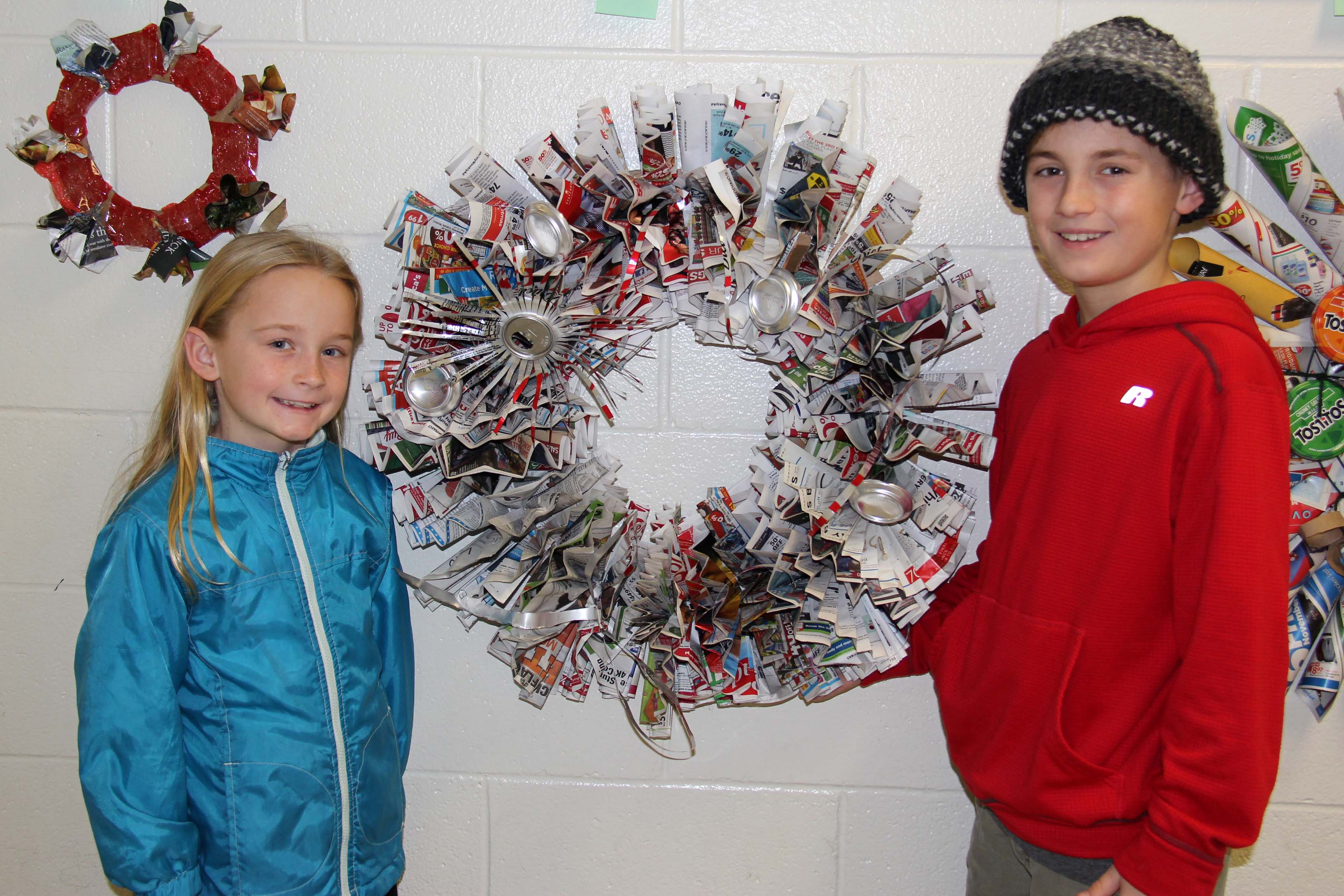 The Razzle Dazzle Recycling Wreath made by the Roche Family won first place in the People's Choice category. A Diet Coke can was transformed into a star to adorn the newspaper wreath.
