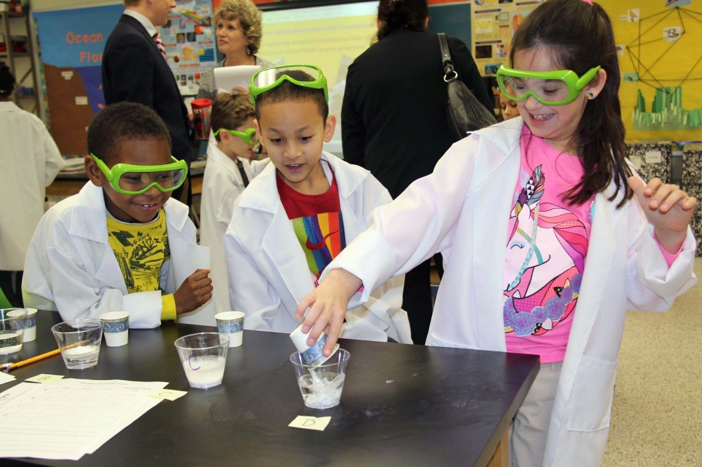 "Tallwood third-graders conduct an experiment using ""mystery liquids"" and baking soda to learn materials' physical and chemical properties."