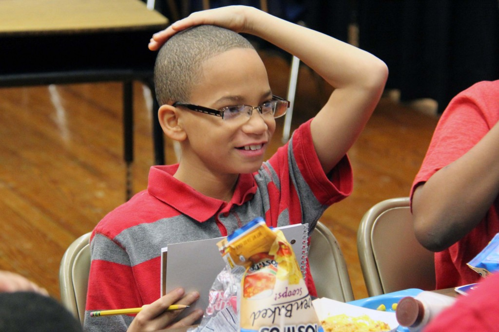 Boys' Club members write in journals to share good news and concerns during their weekly visits.