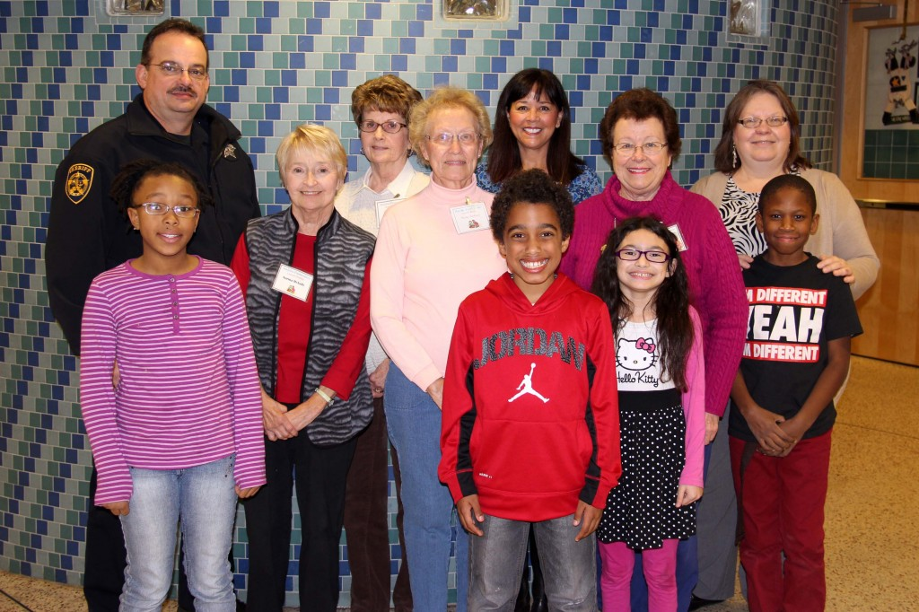 Malibu third- and fourth-graders smile with the mentors who serve as lunch buddies on Wednesdays.