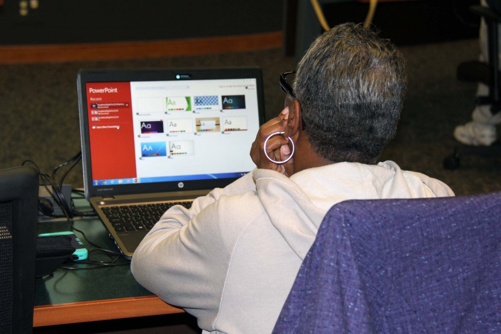 A Parent Connection Technology Academy participant reviews PowerPoint backgrounds.