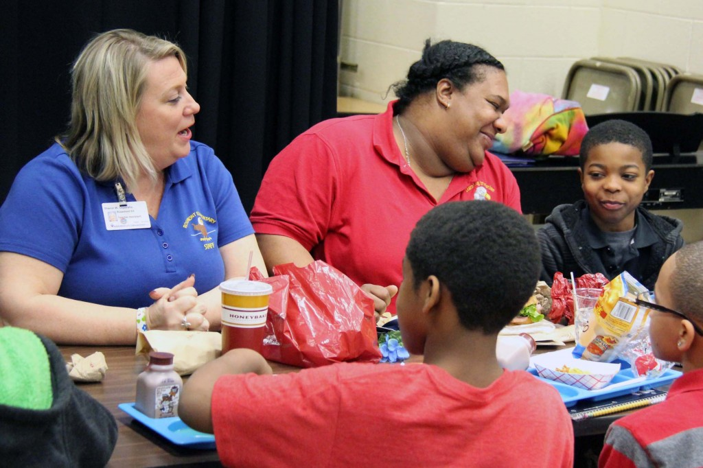 DePeralta (left) and Walker (right) talk with Boys' Club members during lunch.