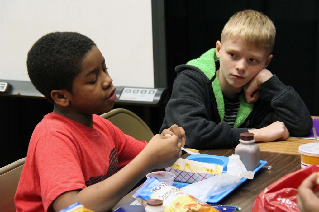 Students listen to one another during Boys' Club lunch meetings.