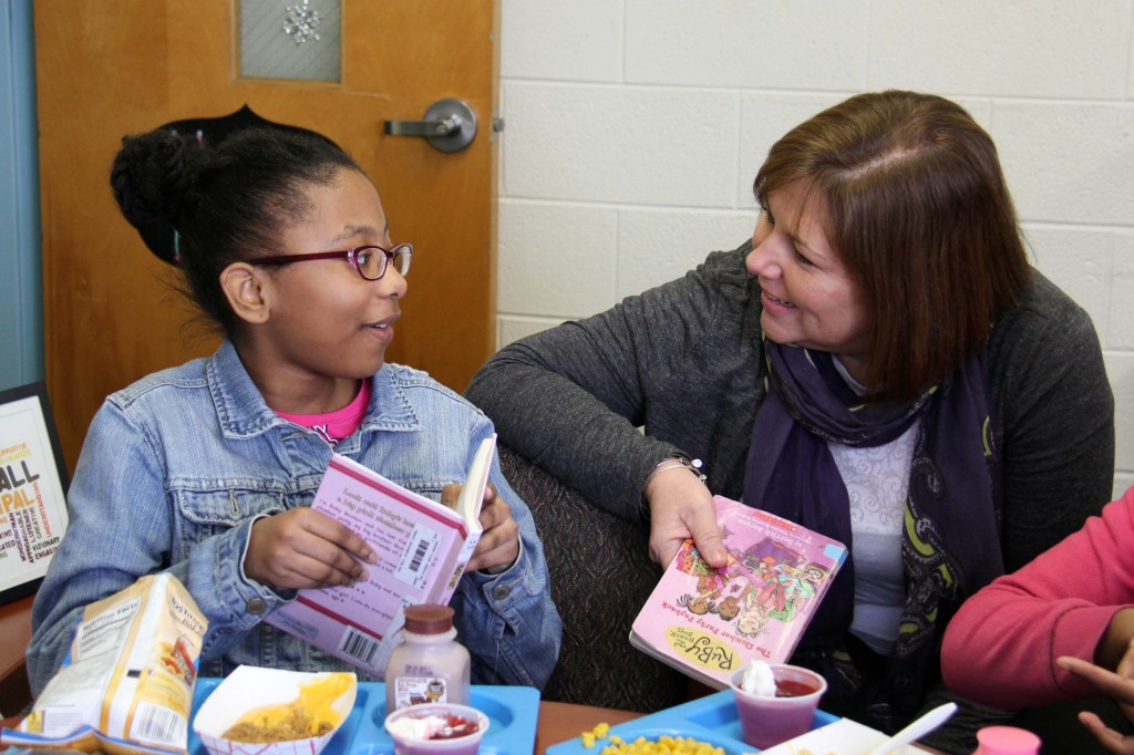 A fourth-grader tells Hall about her favorite part of the chapter.