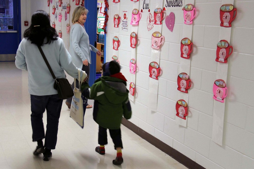 Speech-language pathologist Kathy Scott leads families to kindergarten classrooms.