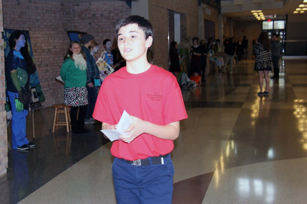 Eighth-grader Haiden Daniels serves as a gallery guide. He hopes to continue his art studies next year at Salem High School's Visual and Performing Arts Academy.