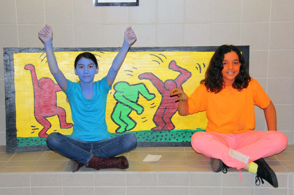 Students Amaya Dinh (left) and Stella Petty (right) pose in artwork by Keith Haring.