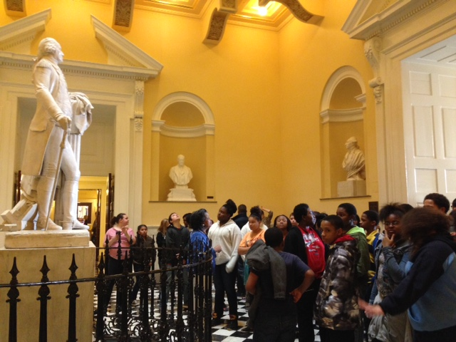 A guide tells Bayside Middle School social studies studients about the statue of George Washington in the Capitol rotunda.