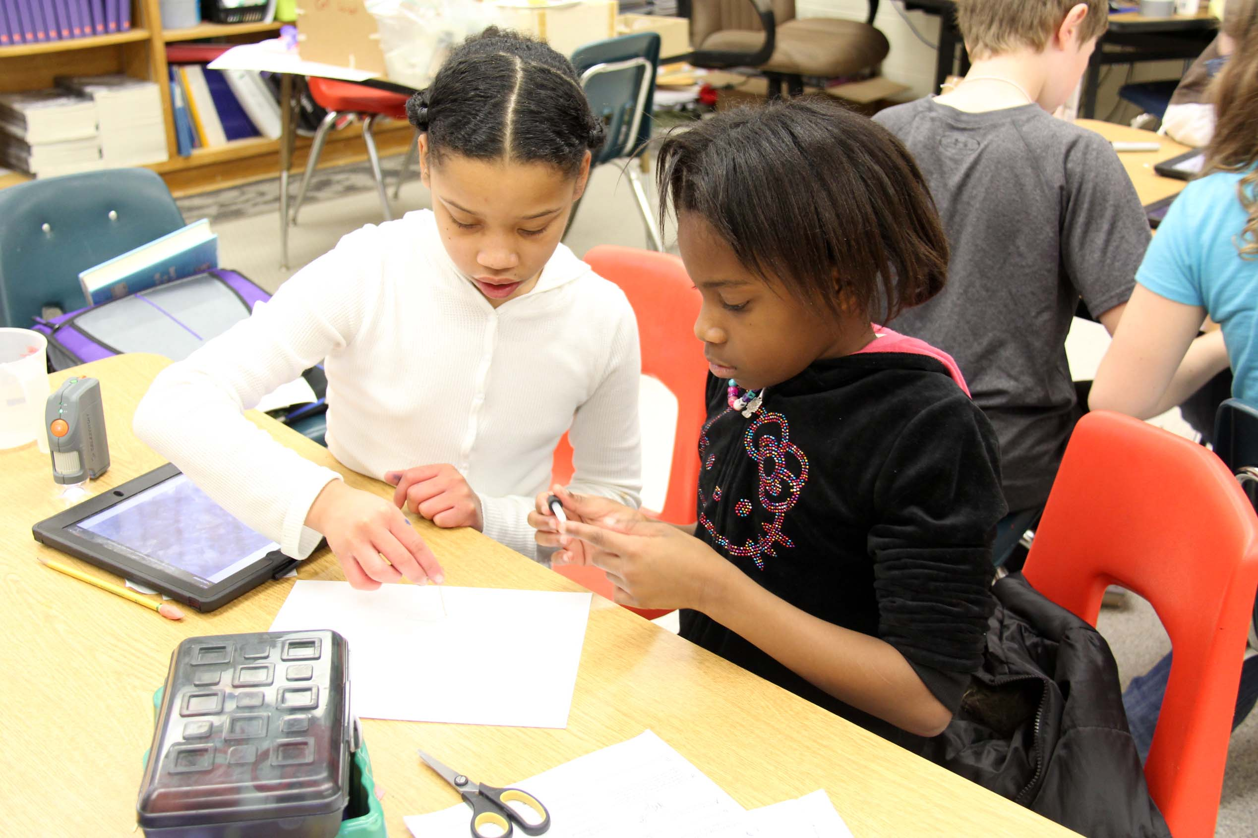 Students work to prepare slides for their microscope.
