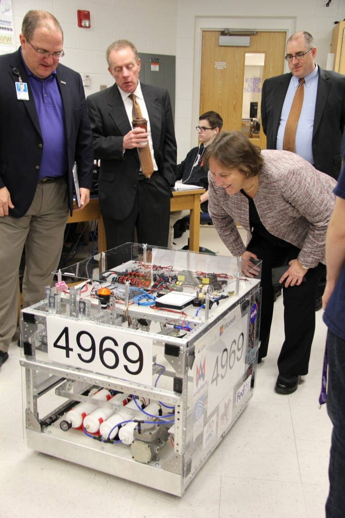 Day takes a close look at Landstown High School's robot, which was built by the students to use in competitions.