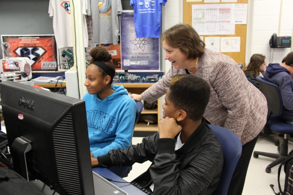 Margo Day talks with students in Landstown High School's Introduction to Robotics class.