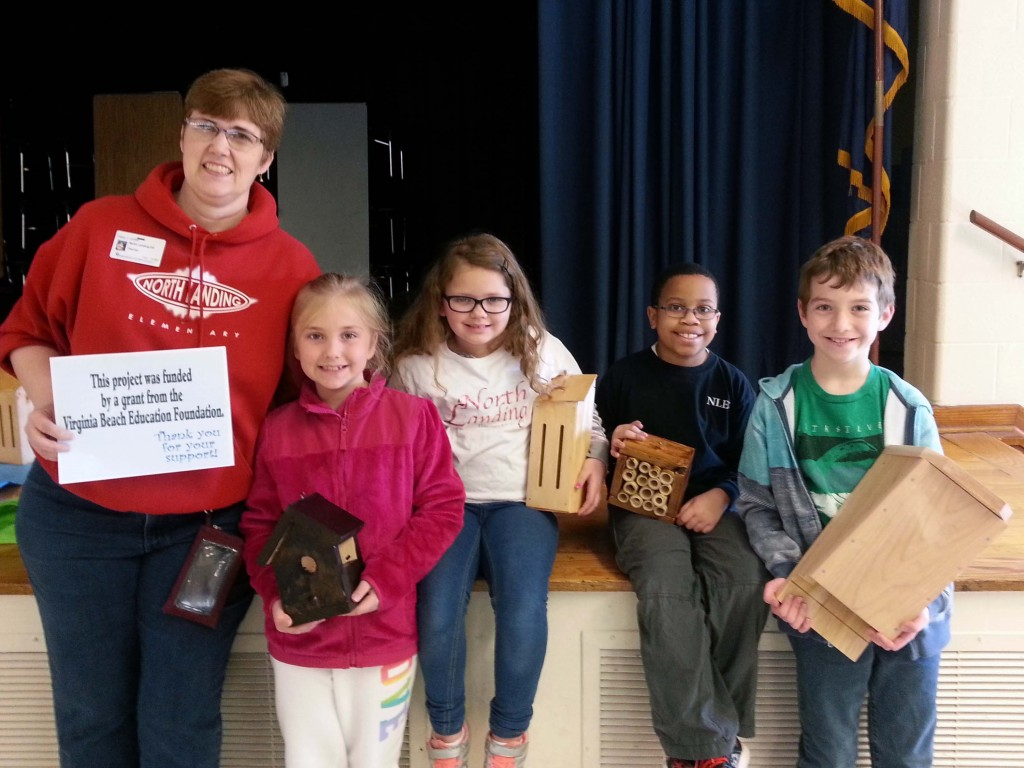 Coffin (left) and members of the NLES ecology club show their finished products.