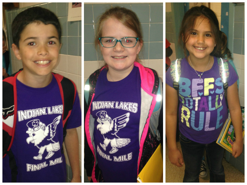 "Students and staff at Indian Lakes Elementary School participated in national ""Purple Up! For Military Kids ""day. Here are Ethan Hoffman, Abigail Riegle and Aurora Barrea."
