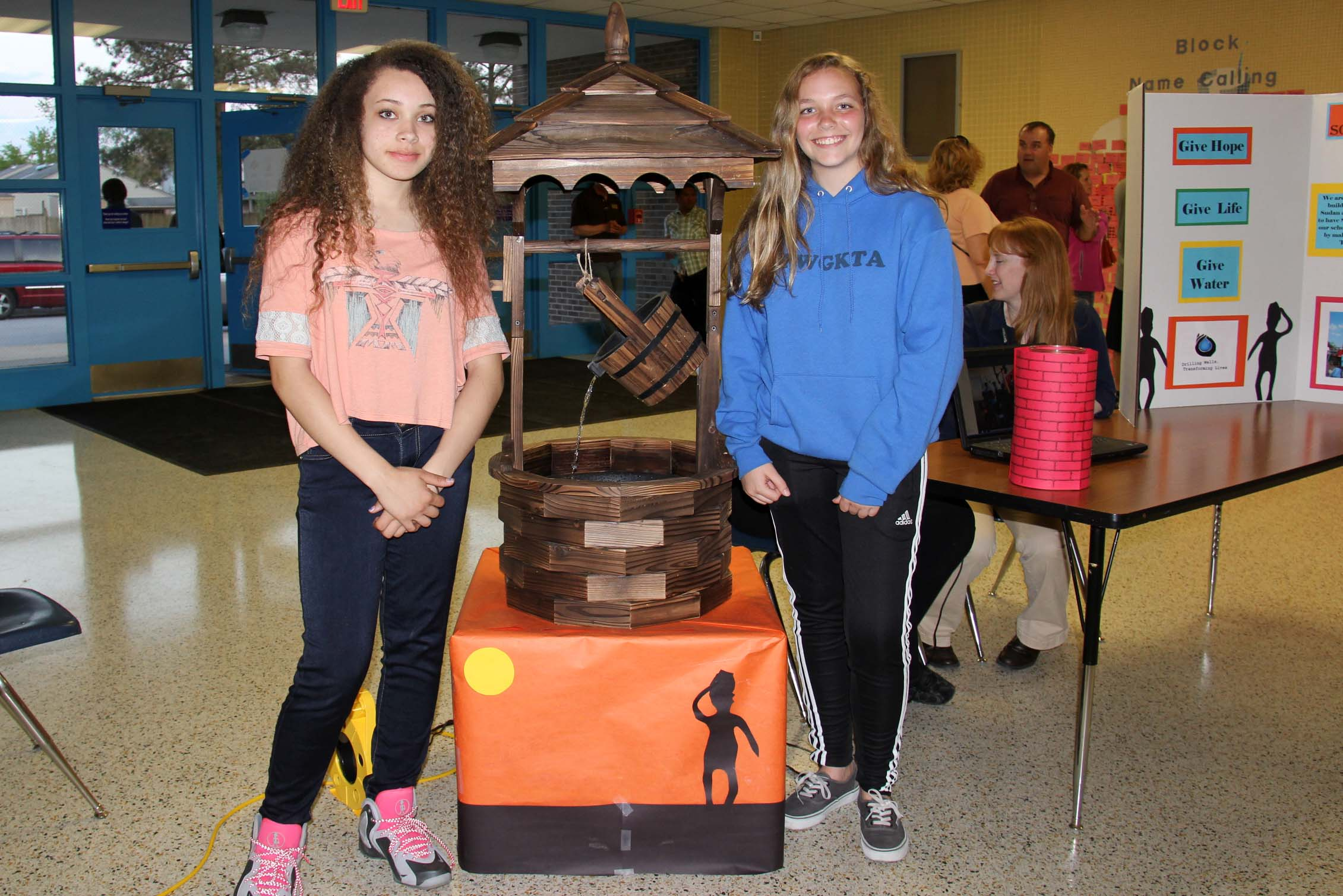 Seventh-graders Cowherd and Hafley hope their school can raise enough money to dig a well in South Sudan.
