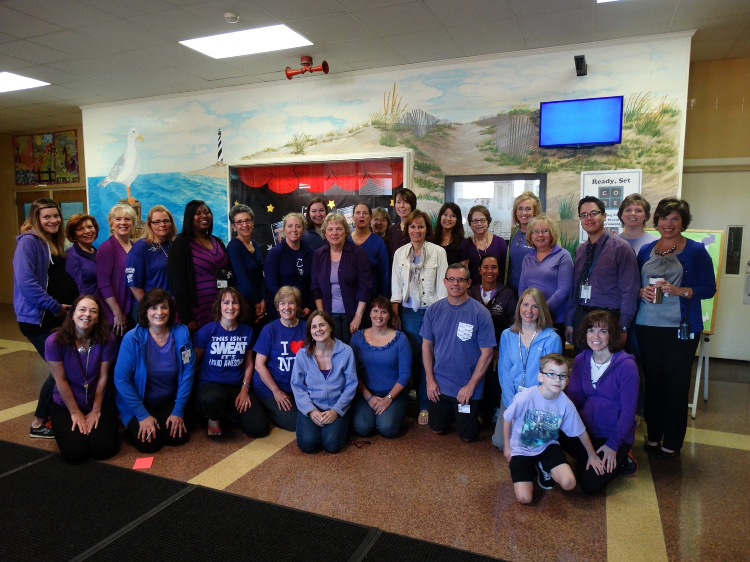 VBCPS celebrates 'Purple Up! For Military Kids' day. Staff at John B. Dey Elementary showed off their purple.