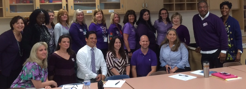 "The staff at Corporate Landing Middle School ""purpled up"" in support of the Military Child."