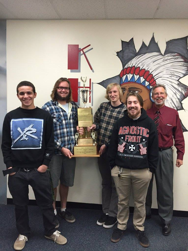"Kempsville High School students Dimitri Hankerson, Cooper Frazier, Jacob Gardner and Christian Bergeron show off their win from the ""Great Computer Challenge."" Pictured with them is principal Bill Harris"